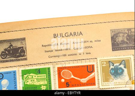 An old fully illustrated stamp album with stamps from Bulgaria - Stock Photo
