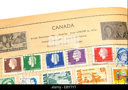 An old fully illustrated stamp album with stamps from Canada - Stock Photo