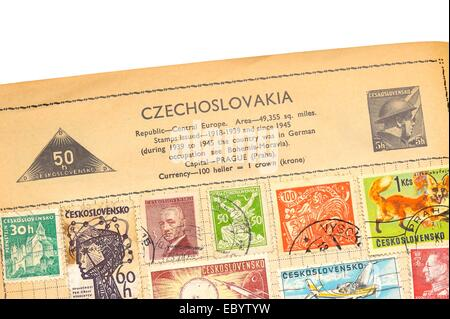 An old fully illustrated stamp album with stamps from Czechoslovakia - Stock Photo