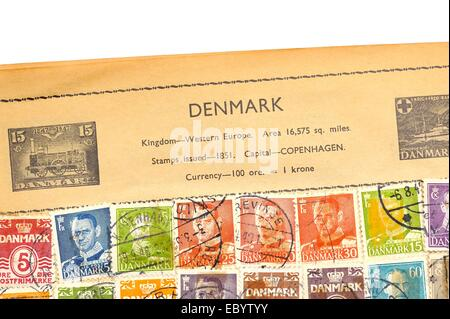 An old fully illustrated stamp album with stamps from Denmark - Stock Photo