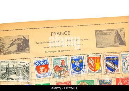 An old fully illustrated stamp album with stamps from France - Stock Photo