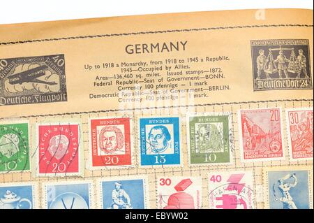 An old fully illustrated stamp album with stamps from Germany - Stock Photo