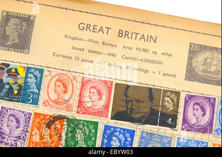 An old fully illustrated stamp album with stamps from Great Britain - Stock Photo