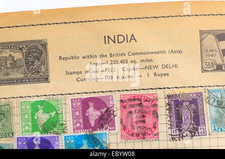 An old fully illustrated stamp album with stamps from India - Stock Photo