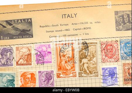 An old fully illustrated stamp album with stamps from Italy - Stock Photo