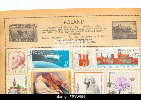 An old fully illustrated stamp album with stamps from Poland - Stock Photo