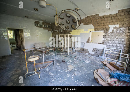 delivery room in City Hospital No. 126 in Pripyat abandoned city, Chernobyl Exclusion Zone, Ukraine - Stock Photo