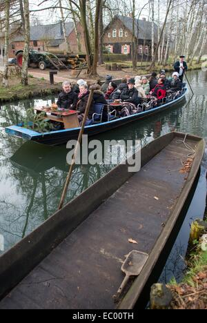 Lehde, Germany. 6th Dec, 2014. Visitors attend a Spree Forest Christmas fair on a boat in the open air museum in - Stock Photo