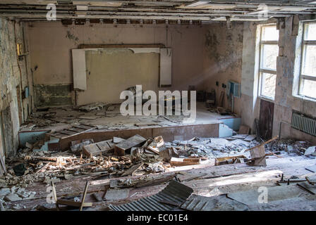Main Auditorium of music school in Pripyat abandoned city, Chernobyl Exclusion Zone, Ukraine - Stock Photo