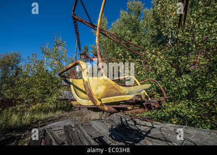 carousel in funfair in city park of Pripyat abandoned city, Chernobyl Exclusion Zone, Ukraine - Stock Photo