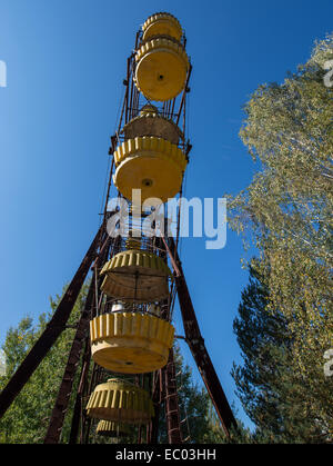 Ferris wheel in funfair in city park of Pripyat abandoned city, Chernobyl Exclusion Zone, Ukraine - Stock Photo