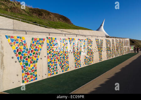 New public climbing wall opened December 2014 at Barry Island writing in Welsh and English, Wales, UK - Stock Photo