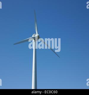 White Wind Turbine and Blue Sky - Stock Photo