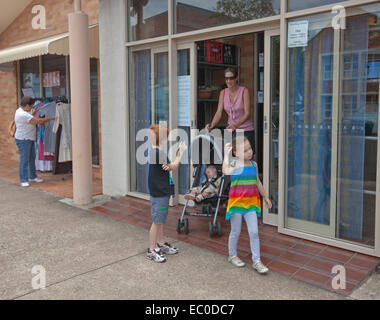 A Woman Shops For Baby Clothing In An Open Air Market Rota