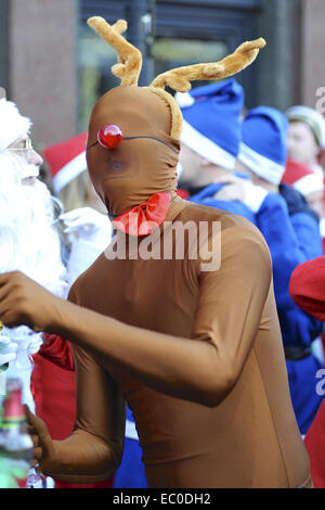 London, UK. 6th Dec, 2014. A man wearing an all in one lycra reindeer suit at the annual 'SantaCon' event in Camden, - Stock Photo