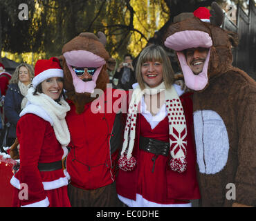 London, UK. 6th Dec, 2014. People dressed as Santa Clause and reindeer at the annual 'SantaCon' event in Camden, - Stock Photo