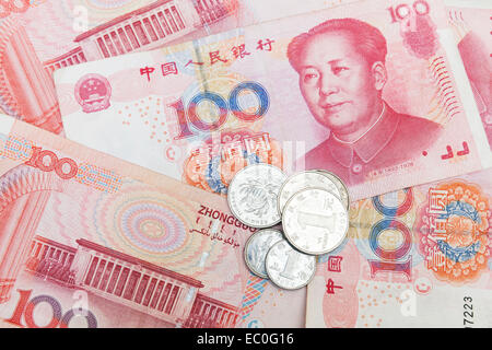 Chinese yuan renminbi banknotes and coins, close up photo background - Stock Photo