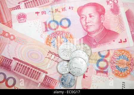 Modern Chinese yuan renminbi banknotes and coins, close up photo background - Stock Photo