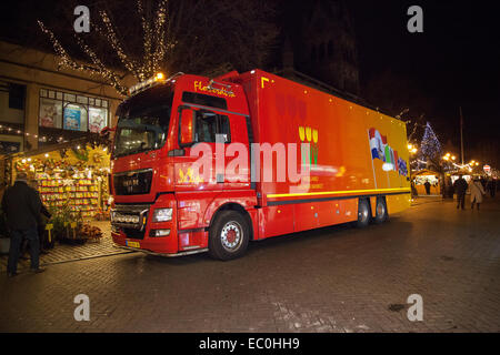 MAN Red Delivery Vehicles 'Holland Flower Market' delivering goods to Chester Christmas Market, Cheshire, UK - Stock Photo