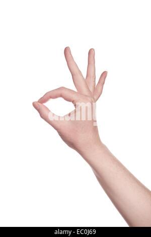 Caucasian white female hand making OK sign isolated on a white isolated background - Stock Photo