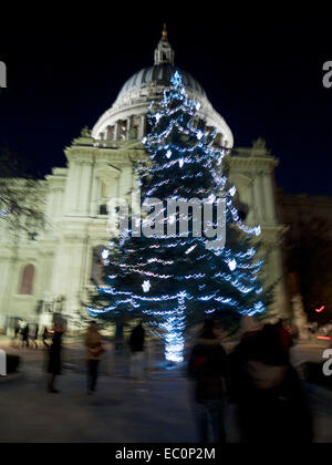 London, UK. Saturday  6 December 2014. Visitors gather round the Christmas tree lit up outside St. Paul's Cathedral - Stock Photo