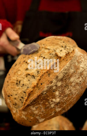 bread being presented in tongs - Stock Photo