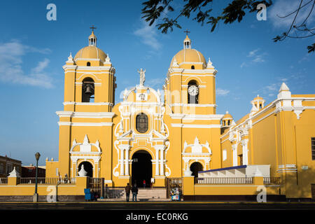 Two people outside the front of the Cathedral in the colonial main square of Trujillo, Peru - Stock Photo