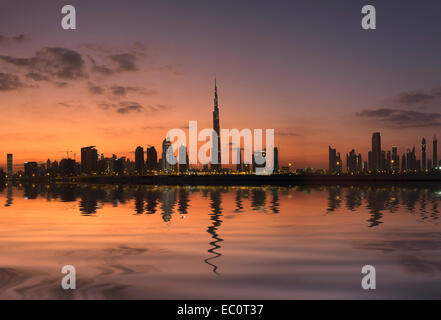 Evening skyline of modern buildings and Burj Khalifa at  in United Arab Emirates - Stock Photo