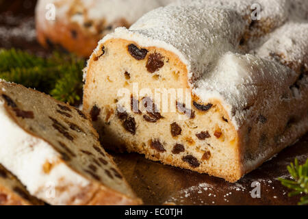 Festive Christmas German Stollen Bread with Powdered Sugar - Stock Photo