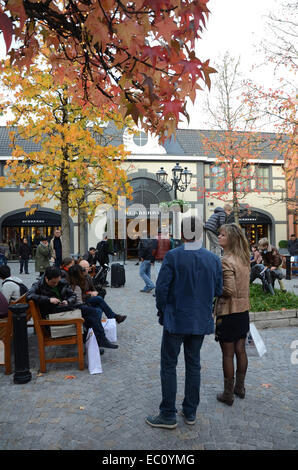 Shopping at McArthur Glen DOC, Roermond Netherlands - Stock Photo