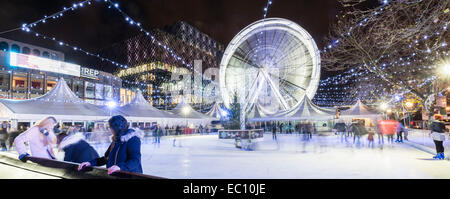 The Christmas ice rink and big wheel outside the Library of Birmingham in Centenary Square. - Stock Photo