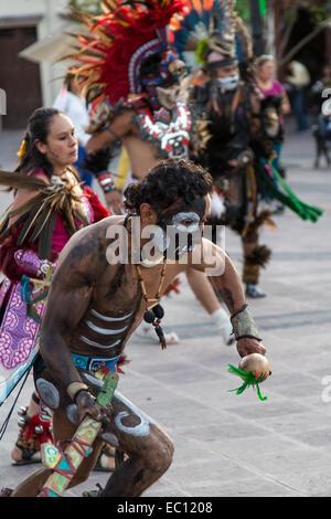 Concheros dancers performing a traditional dance and ceremony on dia de los muertos in Queretaro, Mexico. - Stock Photo