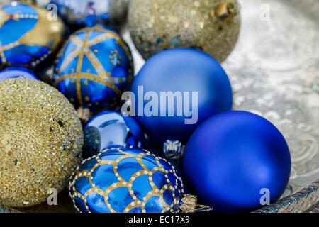 Blue and gold Christmas decorations on a silver tray - Stock Photo