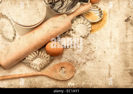 baking ingredients and tolls for dough preparation. flour, eggs, sugar, rolling pin and cookie cutters on white - Stock Photo