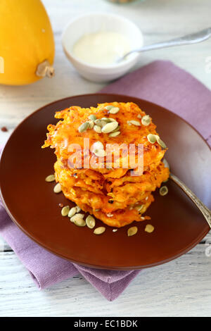 Pancakes with Pumpkin on wooden background, healthy food - Stock Photo