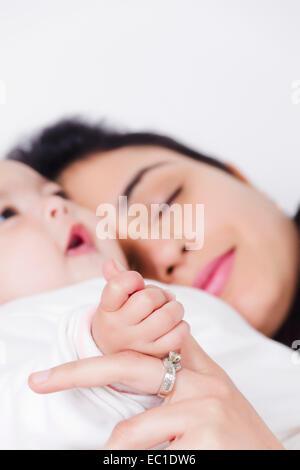 1 Indian Woman Sleeping with Kids - Stock Photo