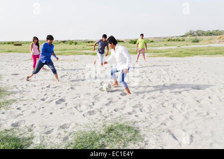 indian friends group Playing Football - Stock Photo