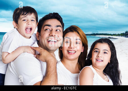 beach side indian Parents with  children fun - Stock Photo