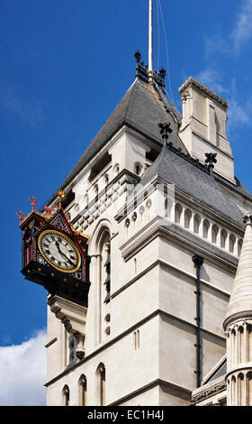 Royal Courts of Justice, huge clock on tower. Fleet St., London. Opened by Queen Victoria, 1882. The Supreme Court - Stock Photo