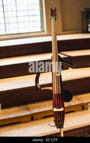 Silent electric upright bass,  double bass, 4-string, on stand - Stock Photo