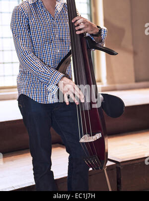 Silent electric upright bass,  double bass, 4-string, being played pizzicato - Stock Photo