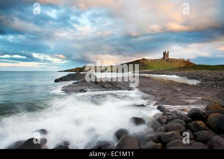 Evening Sky over Dunstanburgh Castle Northumberland Coast England - Stock Photo