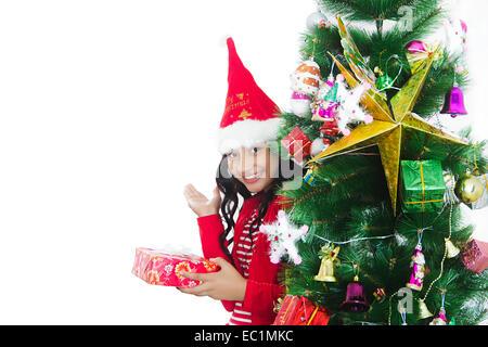 one indian girl Christmas Festival gift - Stock Photo