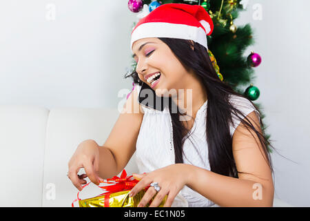 one indian lady Christmas Festival surprise gift - Stock Photo