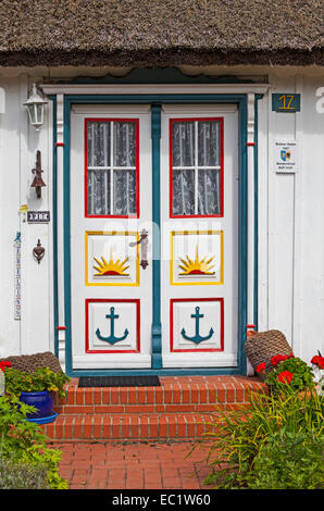 Typical carved and painted door of a wood house, Wieck, Fischland-Zingst, Mecklenburg-Western Pomerania, Germany - Stock Photo