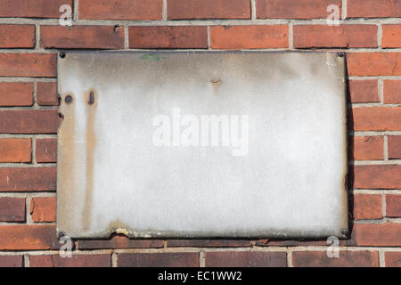 blank retro rusty metal sign on brick wall - Stock Photo