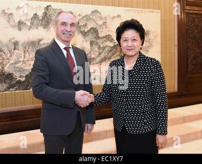 Beijing, China. 8th Dec, 2014. Chinese Vice Premier Liu Yandong (R) meets with the governor of Russia's Ulyanovsk - Stock Photo