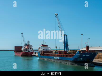 Ship being loaded with coal, cargo port of Livorno, Tuscany, Italy - Stock Photo