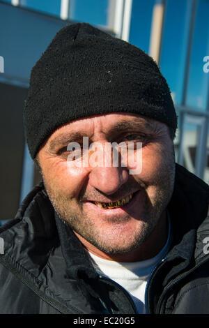 Portrait, friendly Chechen man with gold teeth, Chechnya, Caucasus, Russia - Stock Photo