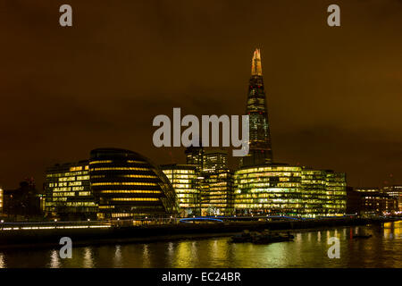 Riverside, City hall and the Shard  lit up at night in London - Stock Photo
